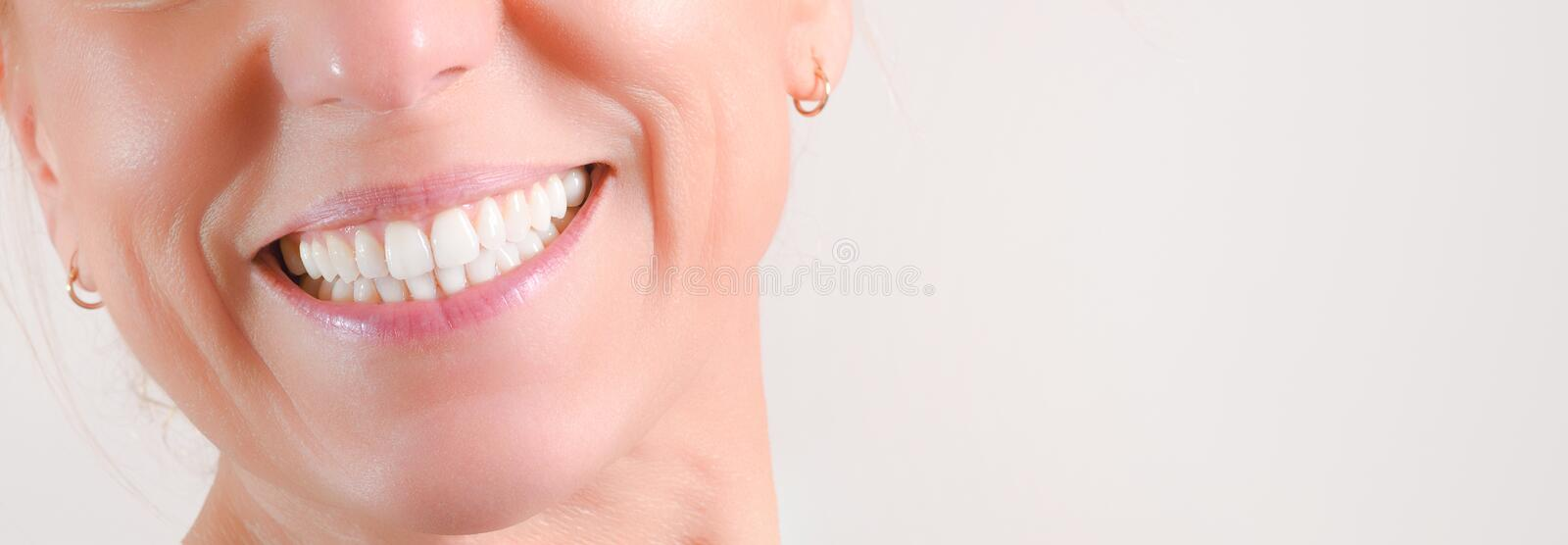 Mature woman showing perfect natural white teeth in front stock image