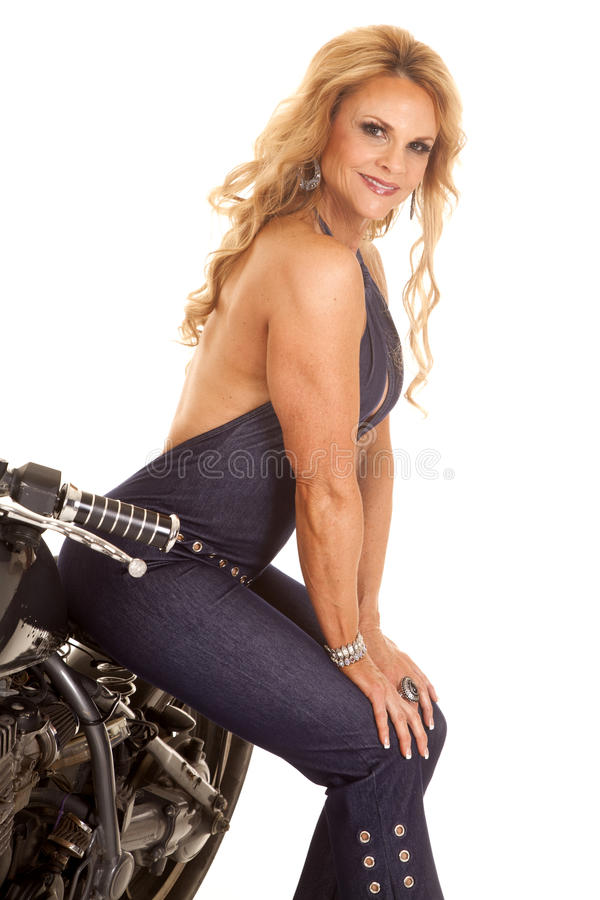 Mature woman sit on motorcycle smiling royalty free stock photos