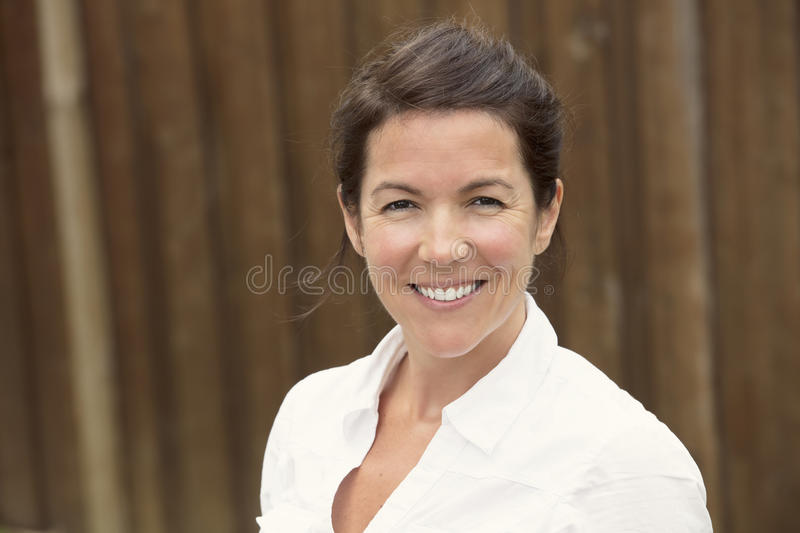 Mature woman smiling outside royalty free stock photography