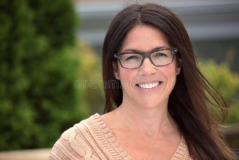Mature woman smiling outside royalty free stock images