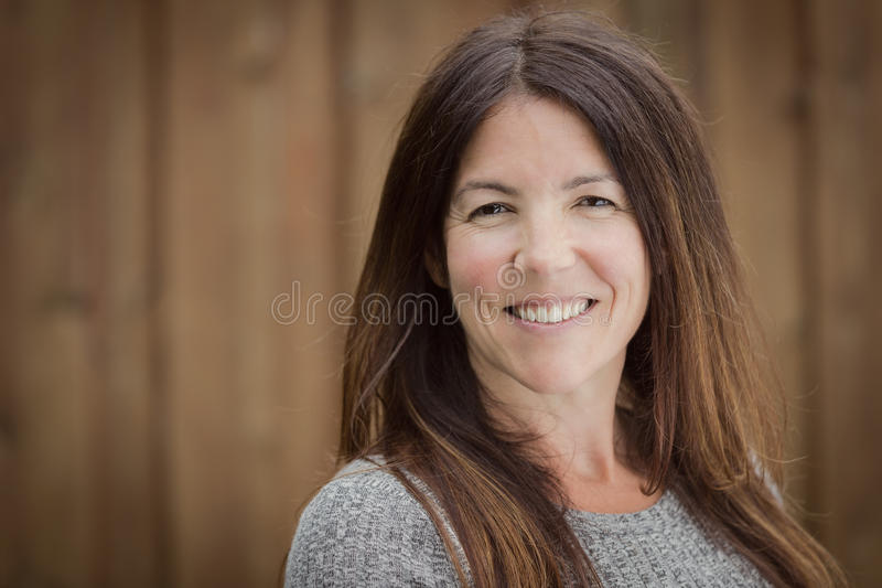 Mature woman smiling outside stock images