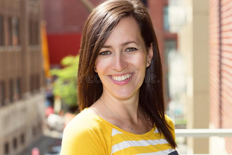 Mature woman smiling. Outside royalty free stock photos