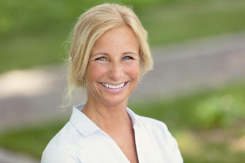 Mature woman smiling. Outside stock photography