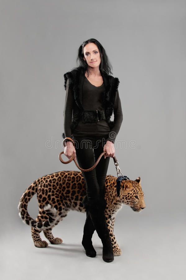 Mature woman and spotty leopard stock photo