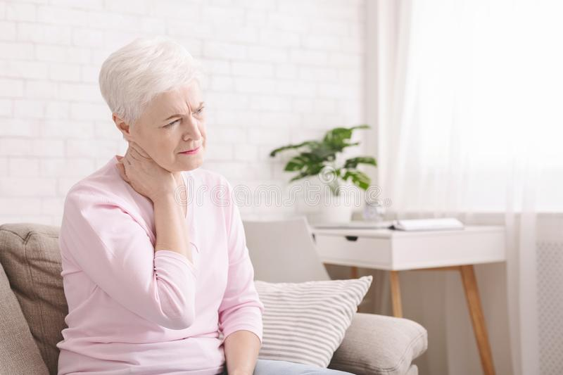 Mature woman suffering from backache at home royalty free stock images