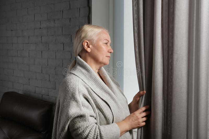 Mature woman suffering from depression royalty free stock image