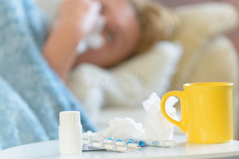 Mature woman suffering from flu or cold stock image