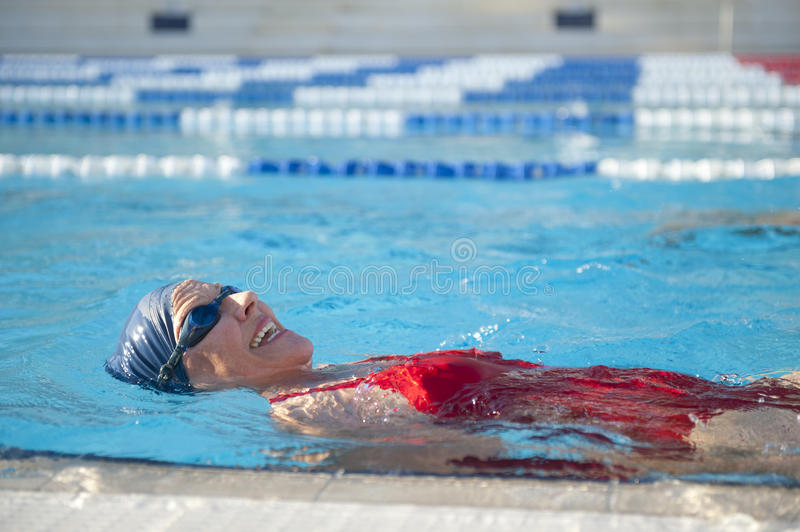 Mature Woman Swimming royalty free stock photography