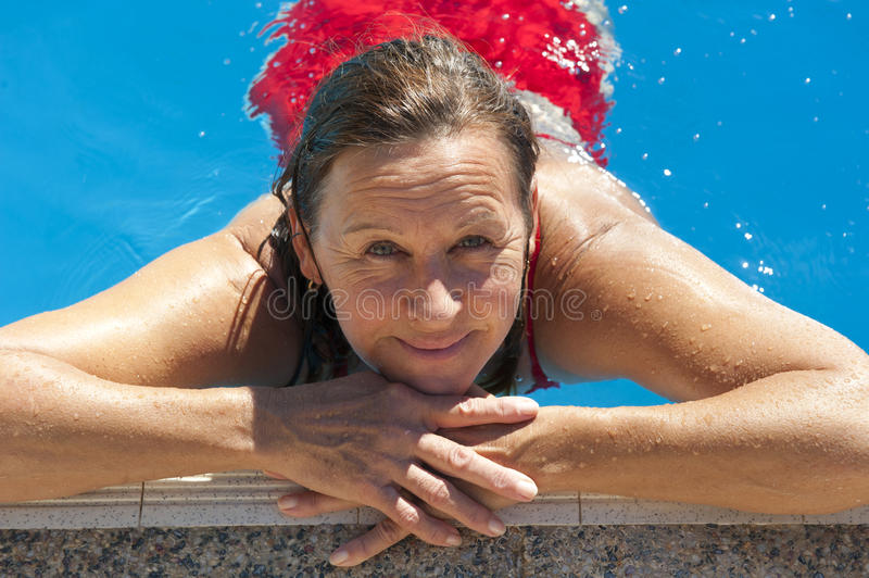 Mature woman in swimming pool stock photos