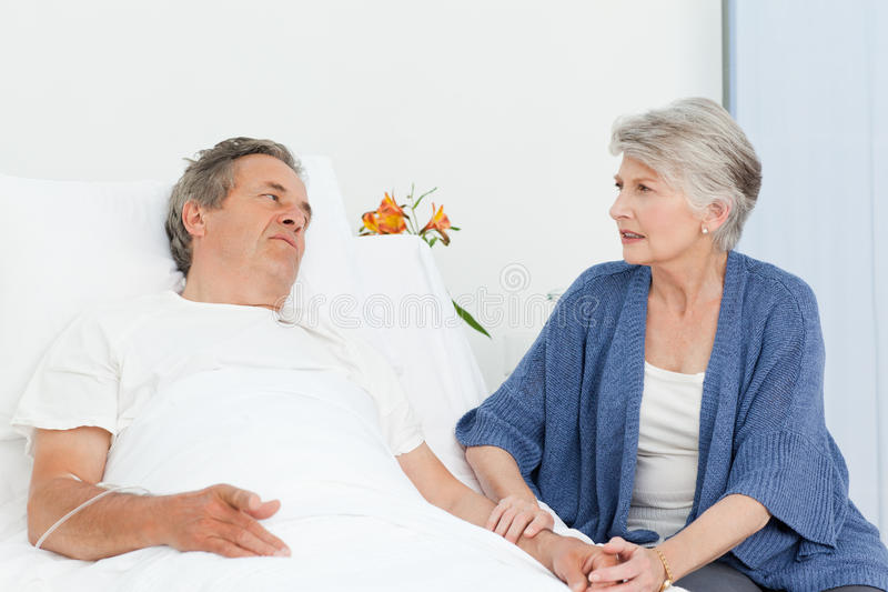 Mature woman taking care of her husband stock photo