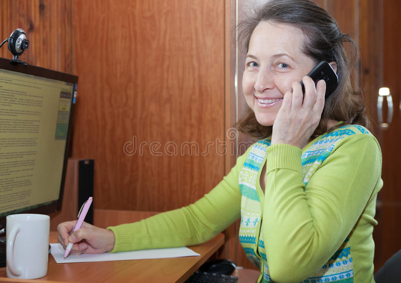Mature woman talking on mobile royalty free stock photo