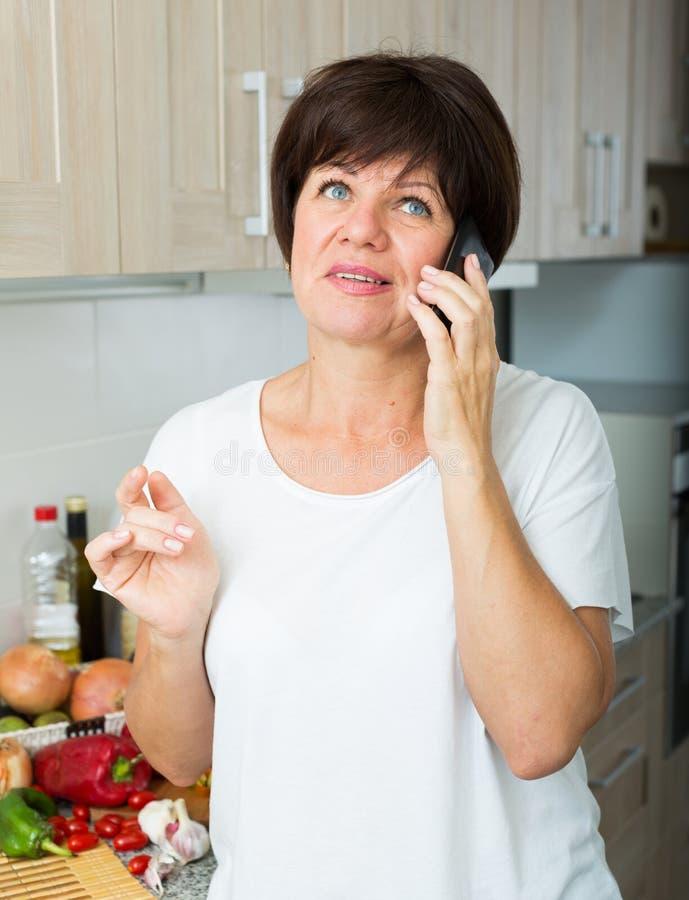 Download Mature Woman Talking Phone Stock Photo - Image: 83702584