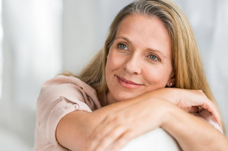 Mature woman thinking stock photos