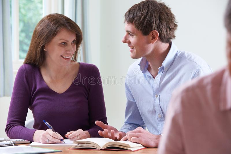 Mature Woman With Tutor In Adult Education Class royalty free stock photography