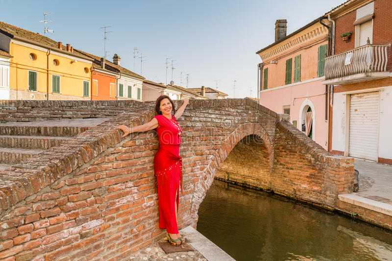 Mature woman in typical town in Italy stock photography