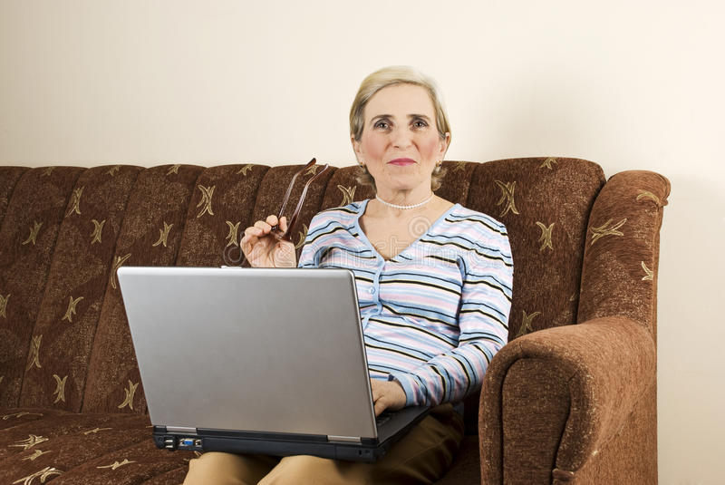 Download Mature Woman Using Laptop Home Stock Image - Image: 12212427