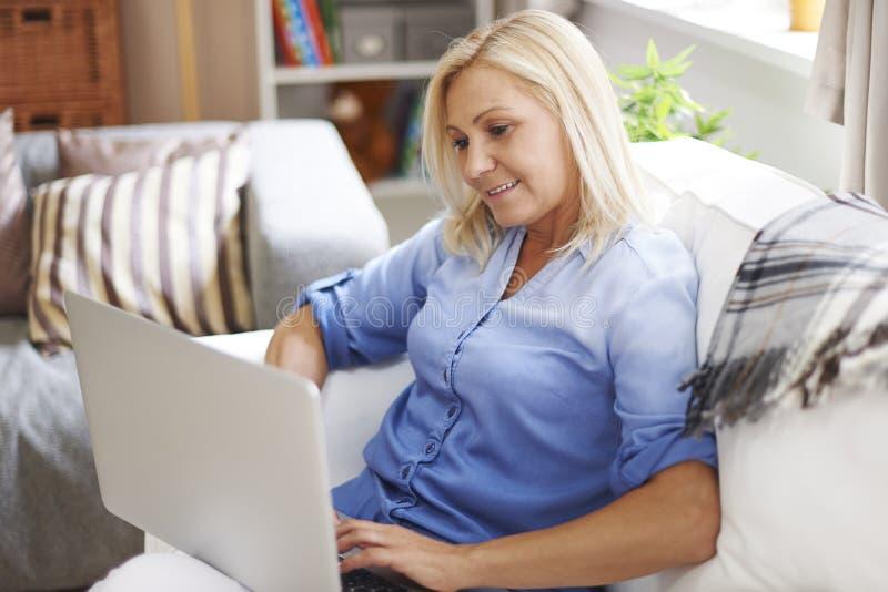 Mature woman using laptop stock image