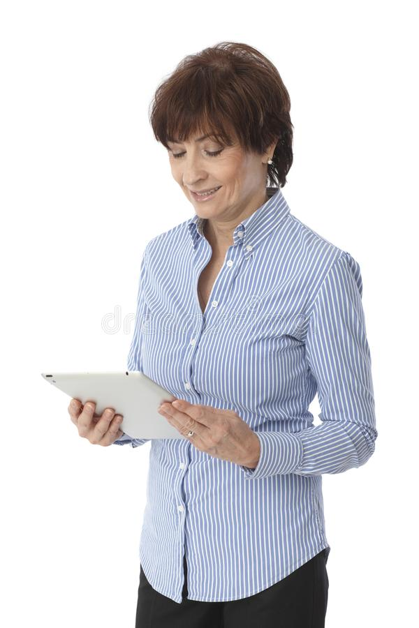 Mature woman using tablet computer royalty free stock images