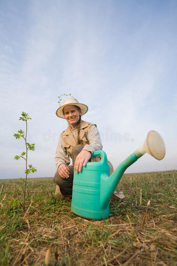 Download Mature Woman With Watering Can Stock Photo - Image of fresh, equipment: 13810234