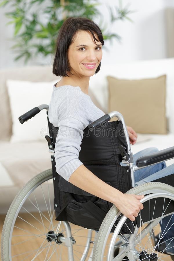 Mature woman in wheelchair indoors royalty free stock photos