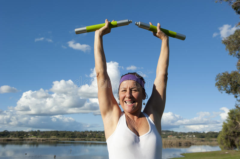 Mature Woman in Winner Pose royalty free stock photos