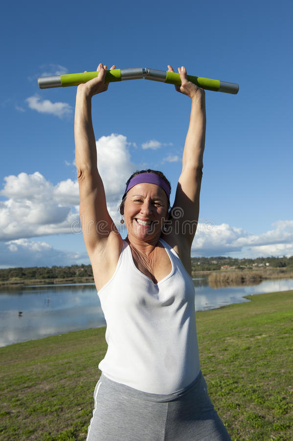 Mature Woman in Winner Pose royalty free stock image