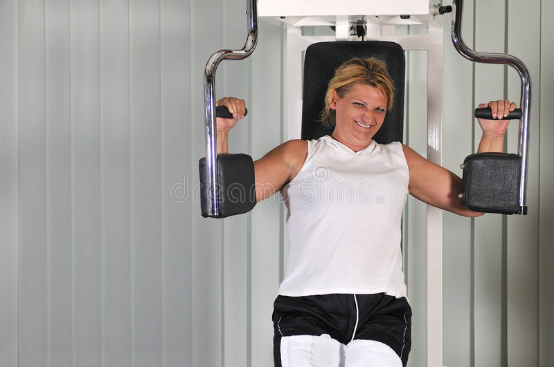 Mature woman work out in fitness stock image