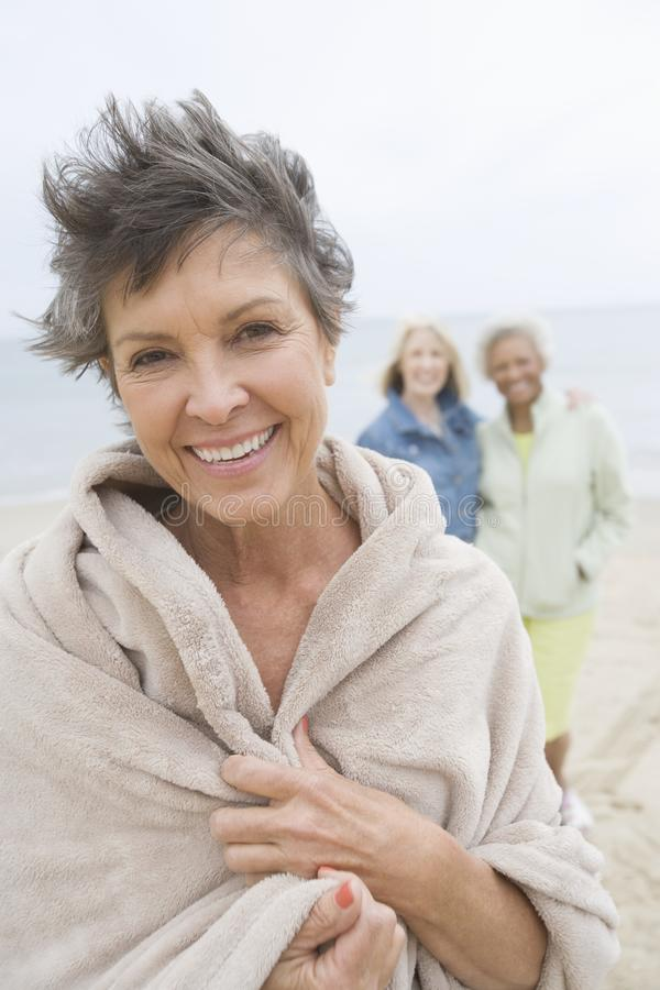 Download Mature Woman Wrapped In Towel On Beach Stock Image - Image: 29664917