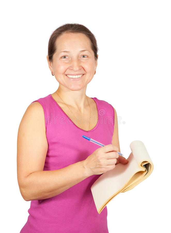 Mature woman writing on notebook stock photography