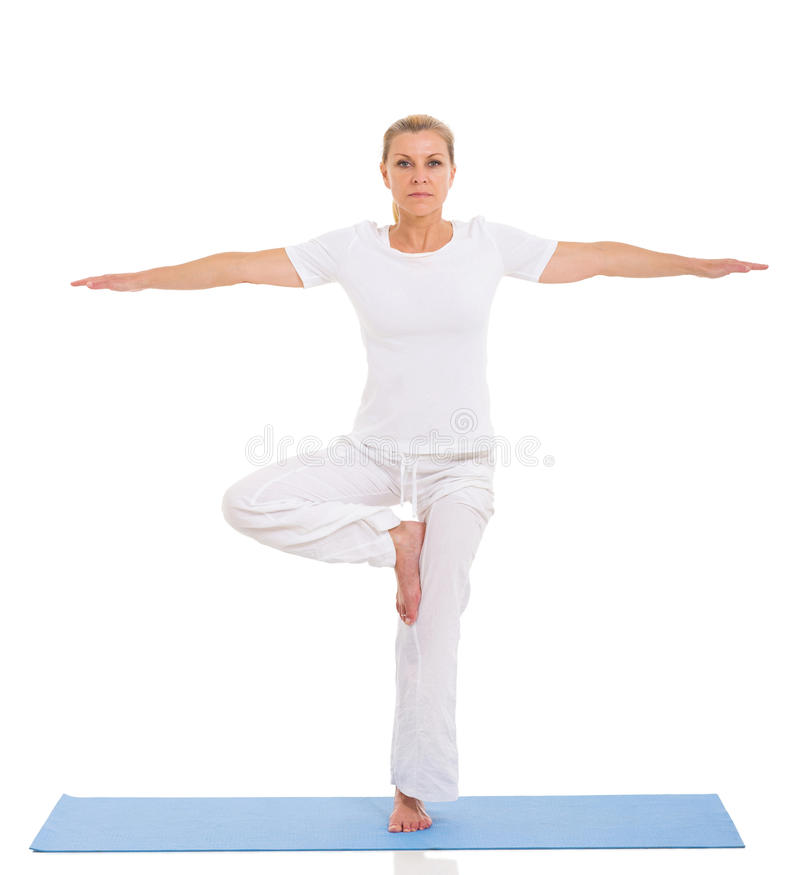 Mature woman yoga. Caucasian mature woman doing yoga exercise on white background royalty free stock photography