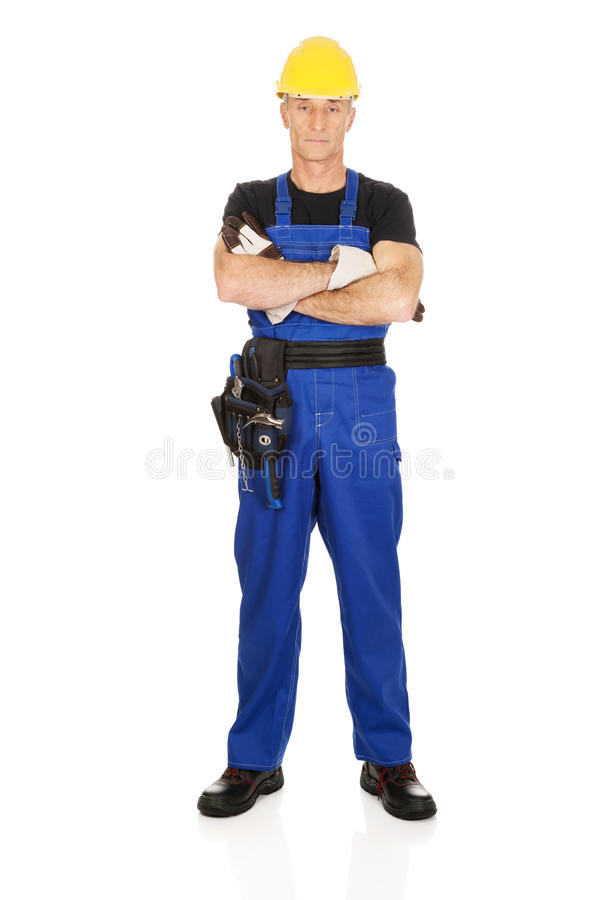 Mature worker with folded arms. Confident mature worker with folded arms royalty free stock photo