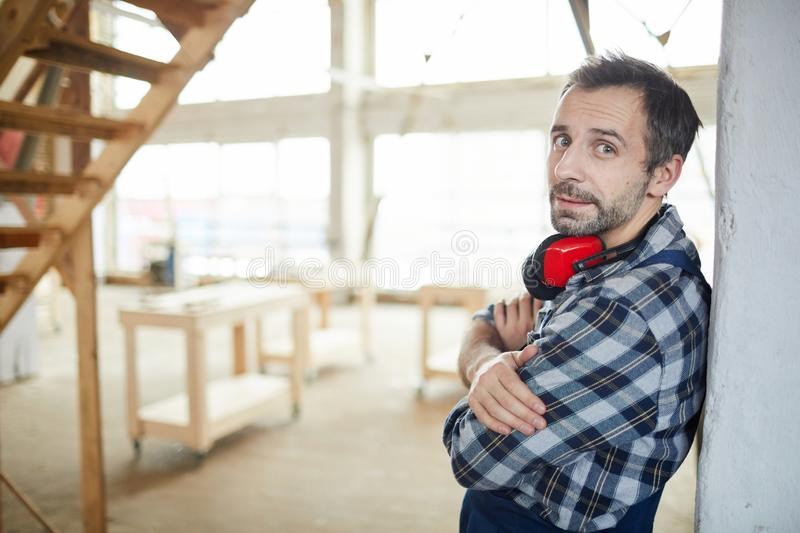 Mature Worker Leaning on Wall royalty free stock photo