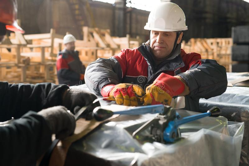 Mature Worker Packing Load at Factory royalty free stock photos