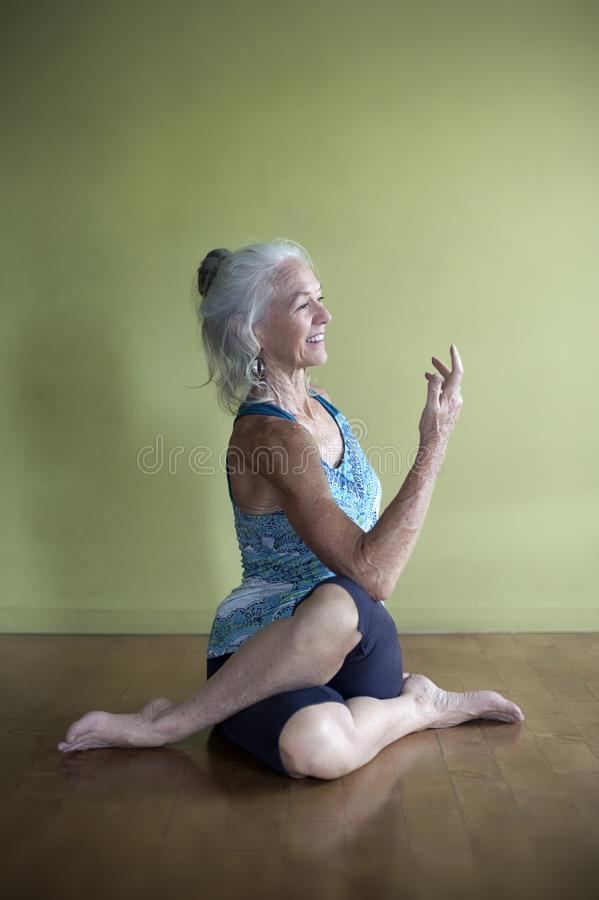 Mature Woman Yoga Studio Practice stock image