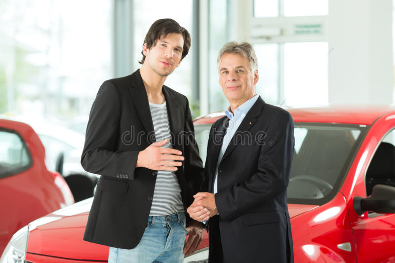 Download Mature And Young Man With Autos In Car Dealership Royalty Free Stock Photo - Image: 26005985