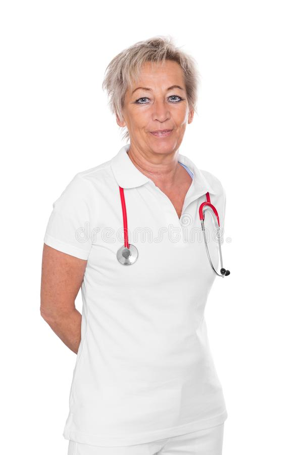 Matured female caregiver, white background stock photo