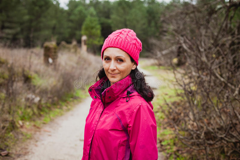 Matured woman in the forest stock photography
