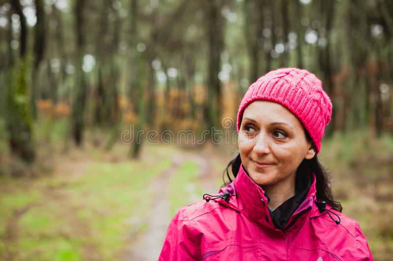 Matured woman in the forest stock images
