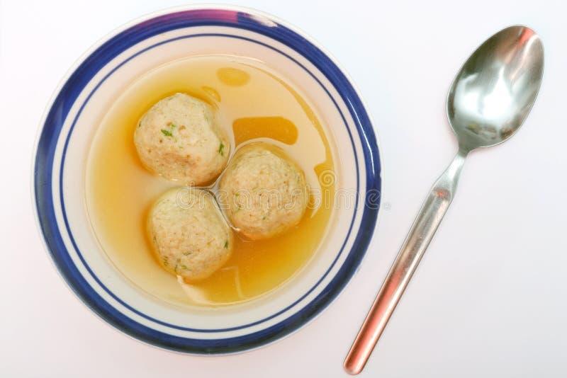 Matzah ball soup. Traditional Jewish matzah ball soup, dumplings made from matzah meal - ground matzo stock photos