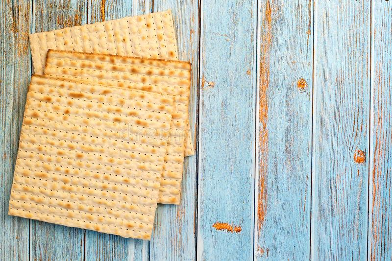 Matzah on blue wooden table. Jewish traditional. Passover bread. Top view. With copy space royalty free stock photo