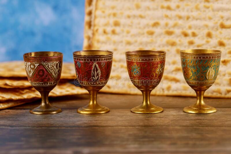 Four wine cups with matzah. Jewish holidays Passover stock image