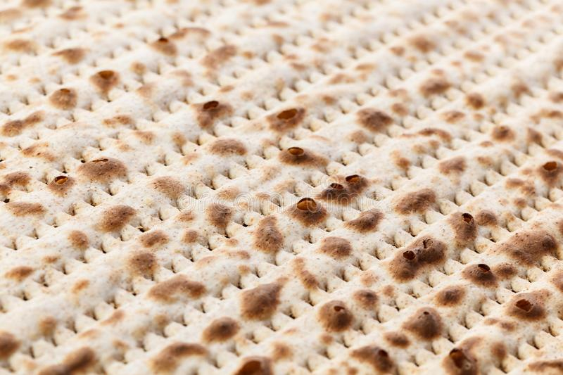 Matzah. Jewish traditional Passover bread. Pesach celebration symbol. Close-up royalty free stock photo