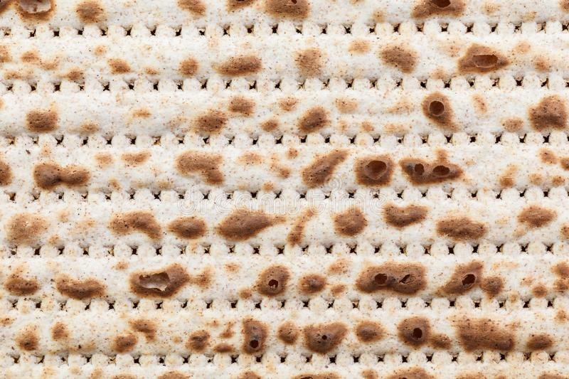 Matzah. Jewish traditional Passover bread. Pesach celebration symbol. Isolated on white. With some free space for your text or sign. Close-up stock photo