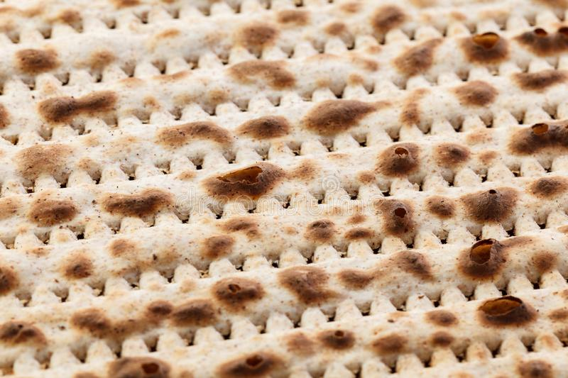 Matzah. Jewish traditional Passover bread. Pesach celebration symbol. Close-up stock photography