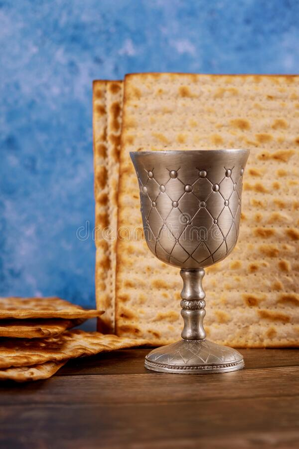 Kiddush silver cup of wine with matzos bread. Jewish pesah holiday royalty free stock photo