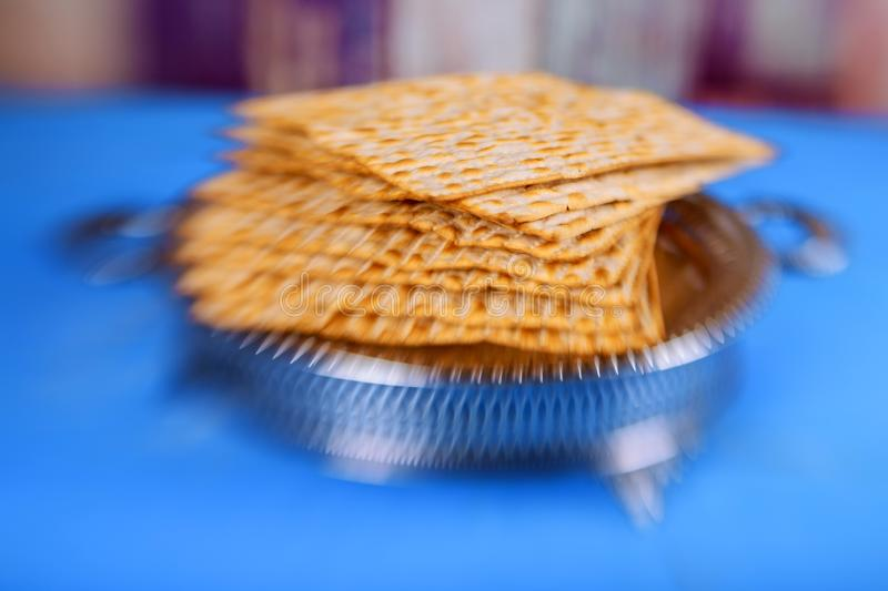 Matzo for Passover with metal tray on table stock photos