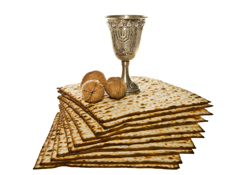 Matzo silver Kiddush cup and walnuts for Passover stock image