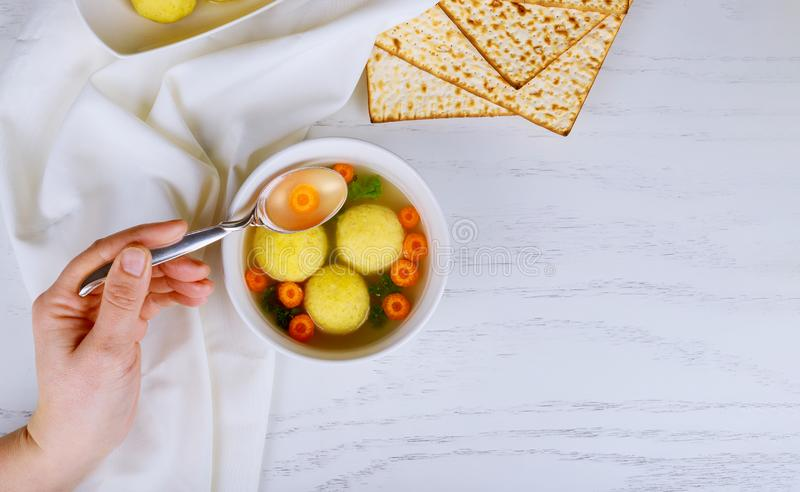 Matzoh ball soup with Pesach Passover symbols. Matzoh ball soup with matzah, Jewish symbols for the Passover Pesach holiday kosher eating meal traditional food stock image