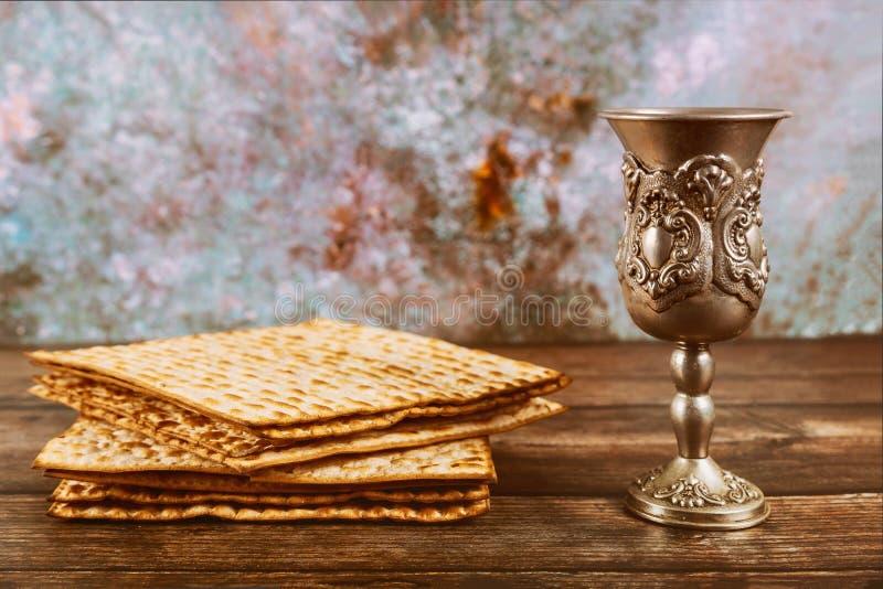 Matzos bread with kiddush cup of wine. Jewish pesah holiday royalty free stock photo