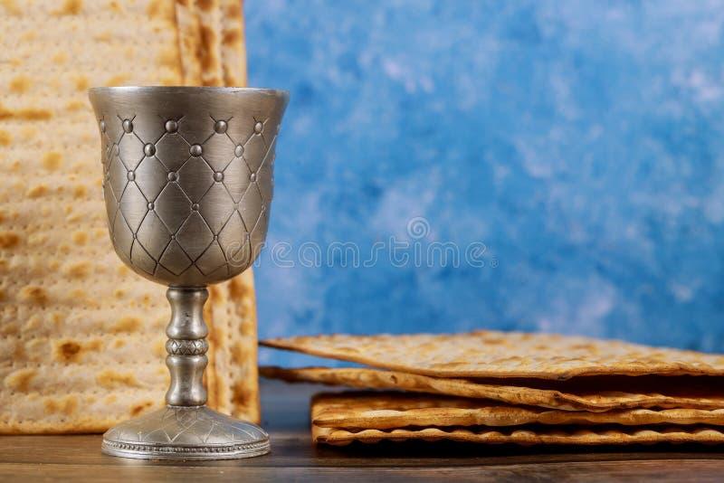 Kiddush cup of wine with matzos bread. Jewish pesah holiday stock photos